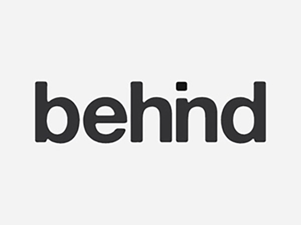 Behind Logo